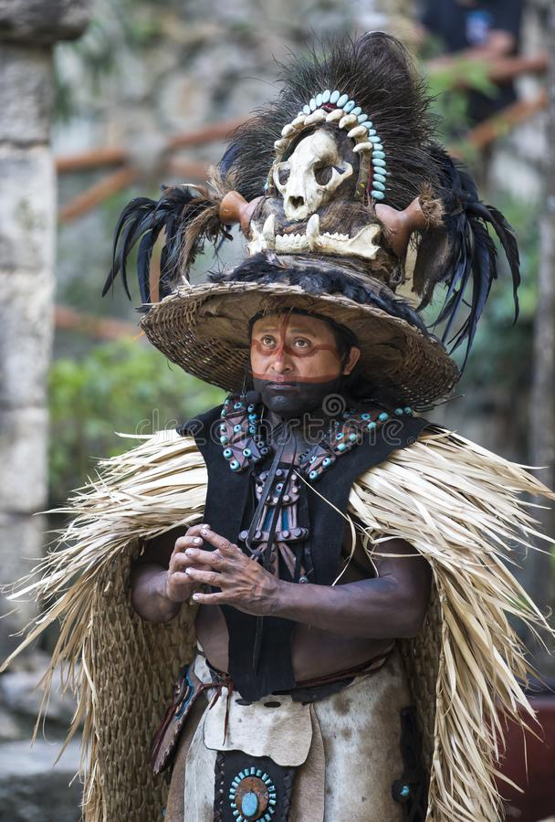 Man in Maya indian costume in Tulum, Mexico. Tulum, Mexico, March 12th, 2017: Man in Maya indian costume royalty free stock images