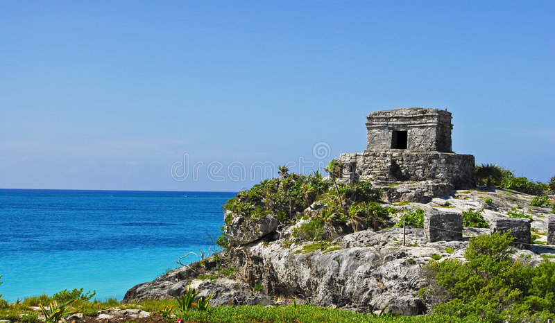 Tulum Ruins in Paradise. Tulum Ruins in Mexico on the Beach. Crystal Blue Ocean in the background royalty free stock photos