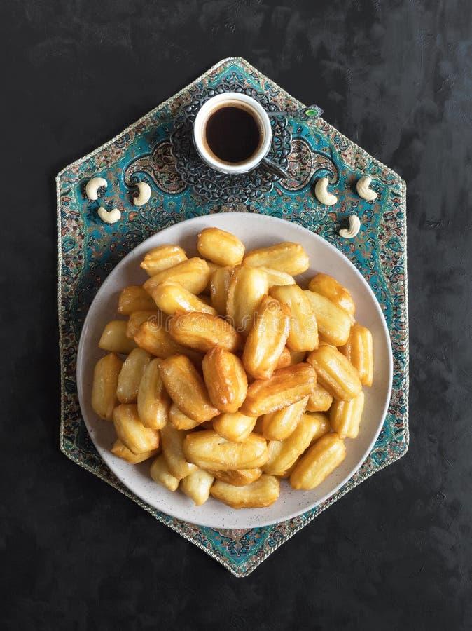 Tulumba Tatlisi - Traditional Turkish desserts Tulumba. Arabic sweets celebration Eid Ramadan.  royalty free stock photos