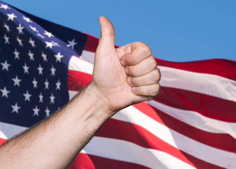 Tumb up sign against of USA flag. Patriotic concept. Tumb up sign against of United States of America flag royalty free stock photography