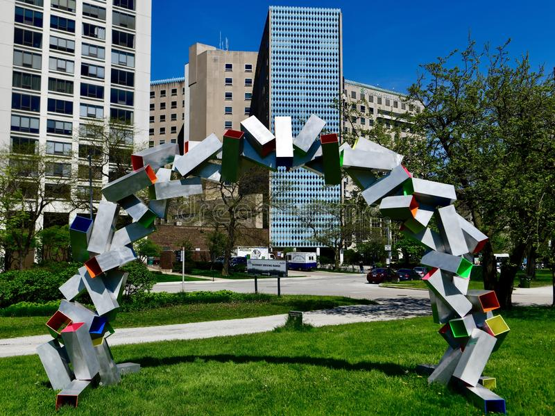 Tumble Arch. This is a Spring picture of a piece of public art titled: Tumble Arch, on display in Lincoln Park located in Chicago, Illinois in Cook County. This stock images