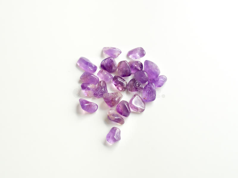 Tumbled Amethyst stones close up from top for crystal therapy tr royalty free stock photo