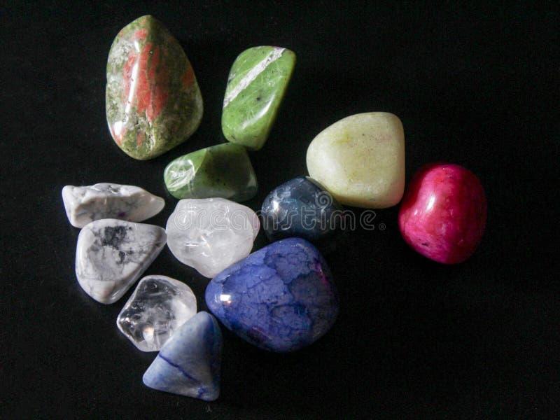 Tumbled Stones on Black Background stock image