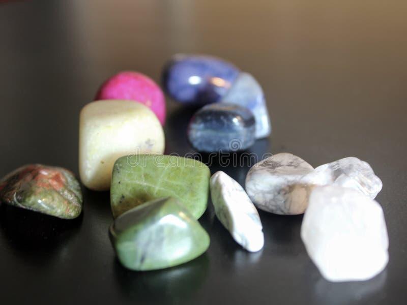 Tumbled Stones on Black Background royalty free stock image
