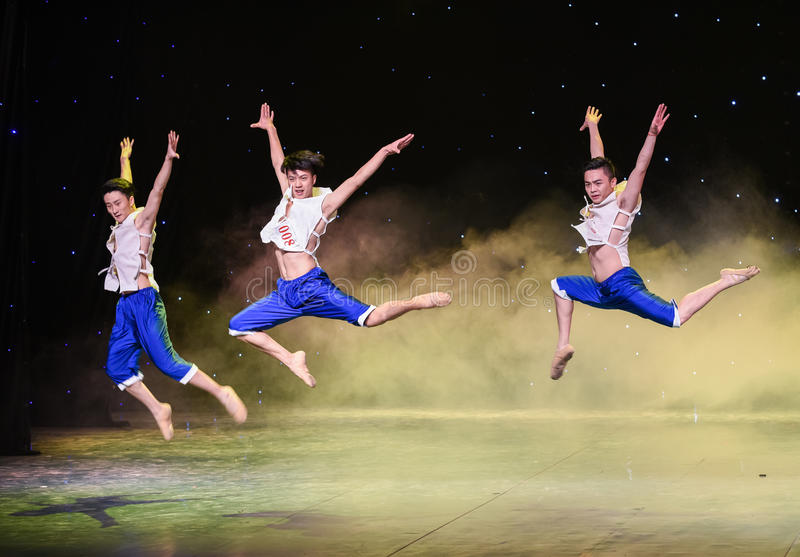 Tumbling jump-The Yellow River Chorus-Group dance. Graduation performance of class5, grade 11, dancing department,Jiangxi Vocational Academy of Art on Dec 26 stock photo