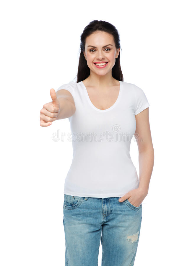 Tummar den vita t-skjortan för lycklig womanin visningen upp royaltyfria foton