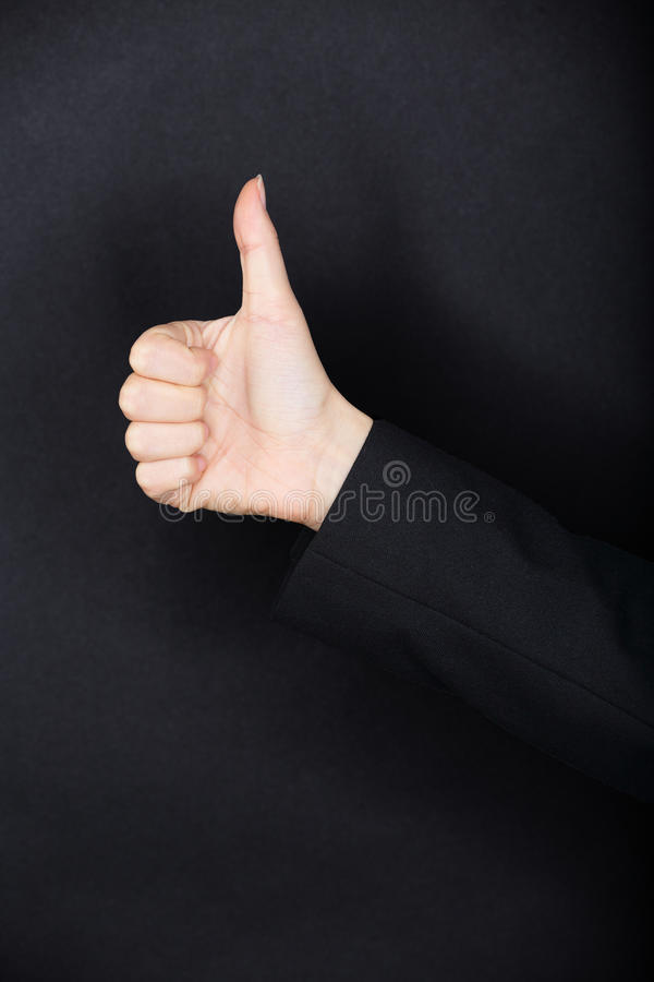 Tummar gör en gest upp arkivfoto
