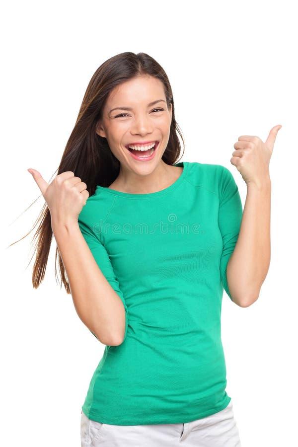 Tummar upp den isolerade lyckliga upphetsade kvinnan royaltyfria foton