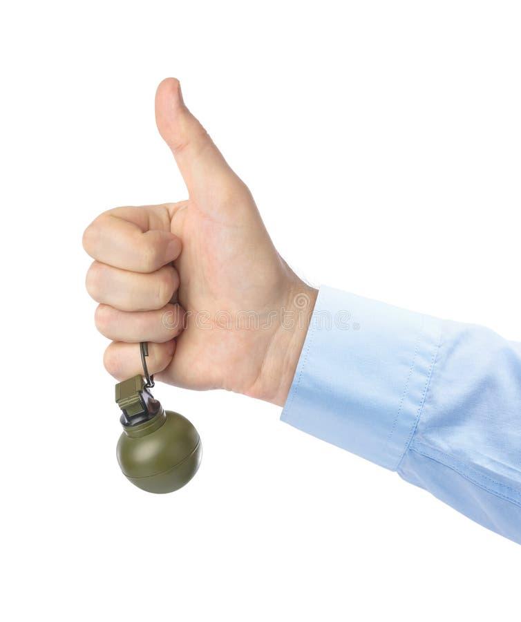 Tumme upp handen med granaten fotografering för bildbyråer