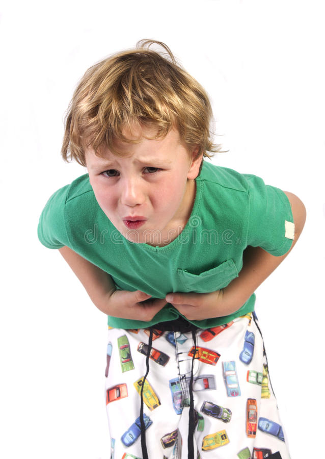 Tummy ache. Boy holding his stomach in pain