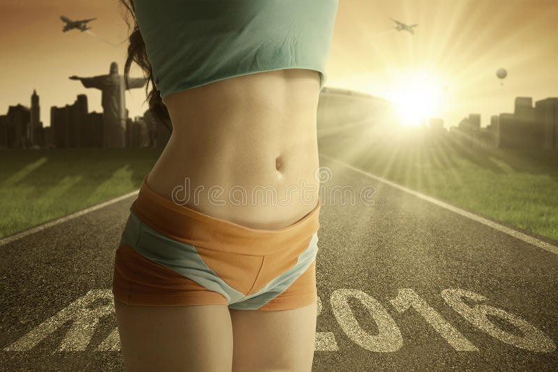 Tummy of woman with text Rio 2016 royalty free stock photography
