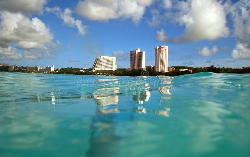 Tumon Bay, Guam. Photo taken from the water looking toward Tumon Beach, in Guam USA royalty free stock image