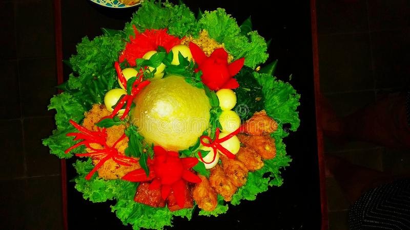Tumpeng rice with various vegetables from Yogyakarta Indonesia. Food, tomato, egg, chili, salad, green, red, yellow stock images