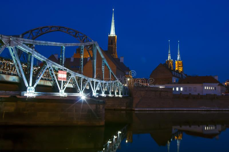 Tumski Bridge and Cathedral of St. John the Baptist twin towers on Ostrow Tumski. stock image