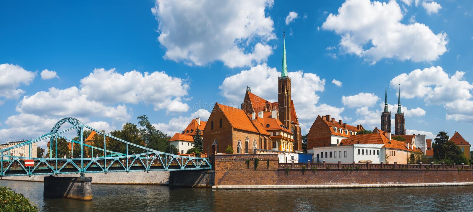 Tumski Bridge and Island in Wroclaw, Poland. Famous tourist destination in Wroclaw. Tumski Bridge over Oder river and Cathedral Tumski Island are the oldest part stock photos