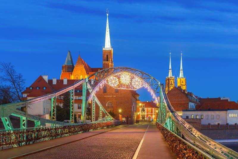 Tumski Bridge at night in Wroclaw, Poland royalty free stock photos