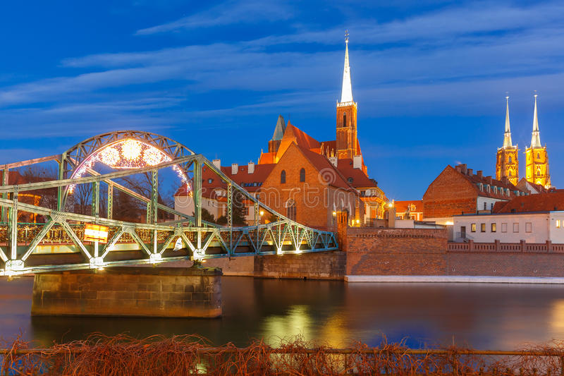 Tumski Bridge at night in Wroclaw, Poland royalty free stock images