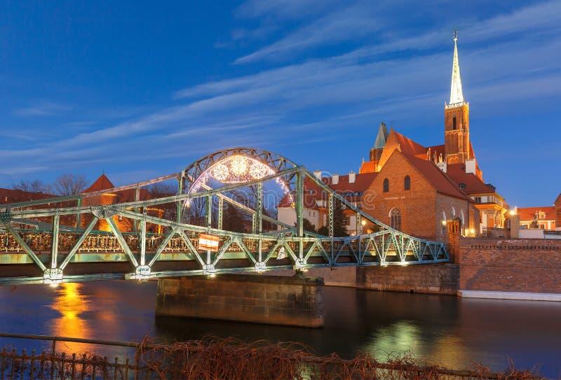 Tumski Bridge at night in Wroclaw, Poland stock photography