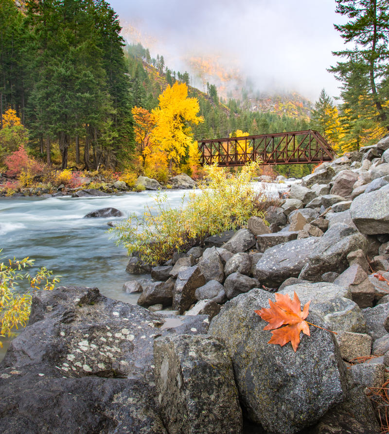 Tumwater river flow along the Leavenworth in Autumn. Autumn in Leavenworth with bridge cross over in Wenatchee royalty free stock images