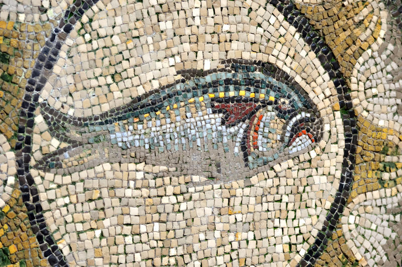 Tuna. Ancient roman mosaic of a tuna from the UNESCO listed floor of the 4th century basilica of Aquileia in Italy royalty free stock photo