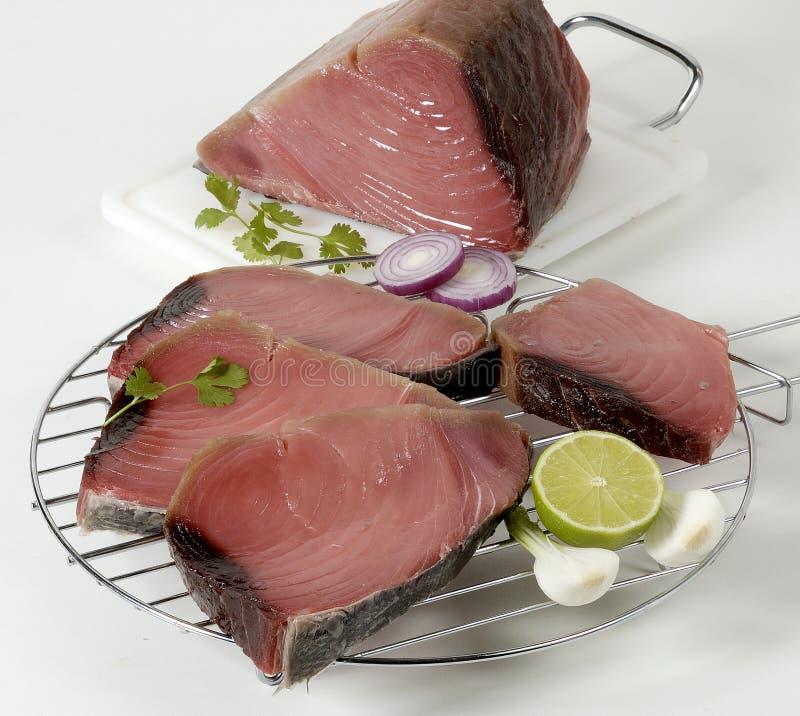 Tuna. Sliced raw tuna with lime, garlic, onion and herbs