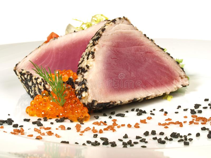 Tuna Appetizer - Fish Fillet with red and black Salt royalty free stock photography