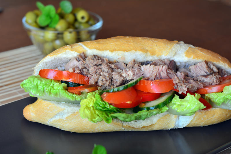 Tuna Baguette With Vegetables On The Brown Plate stock photo