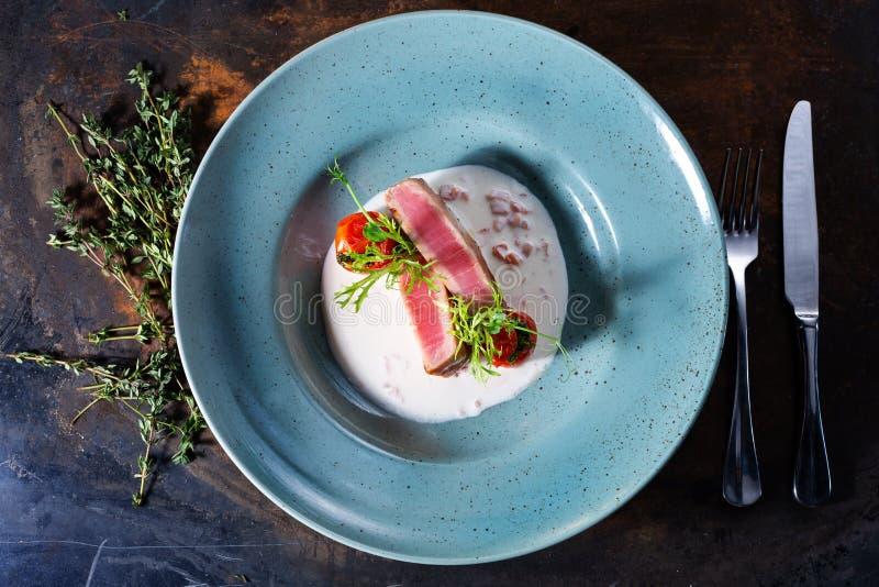 Tuna steak in cream sauce. Tuna dish in cream sauce stock images