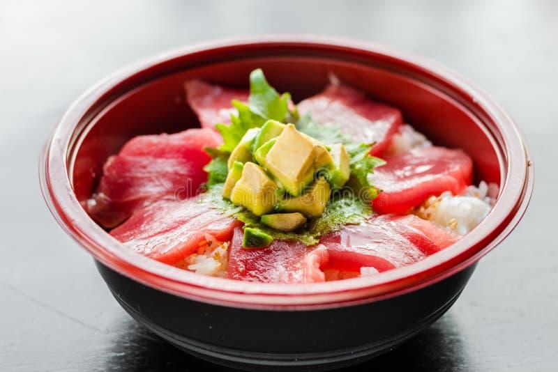 Tuna Donburi. Bowl on black reflective wood surface royalty free stock images