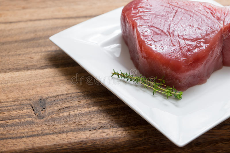 Tuna Filet. Raw Tuna Filet on plate royalty free stock images