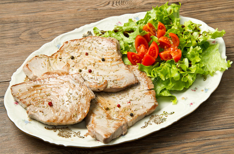 Download Tuna filet with salad stock photo. Image of cooked, lettuce - 23617826