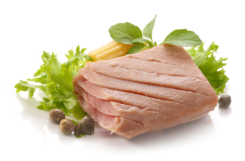 Tuna fillet. Piece of tuna fillet with fresh green lettuce, basil and mini corn royalty free stock image