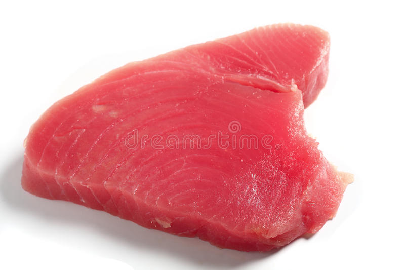 Tuna fish steak. Bluefin tuna (blue ahi tuna) steak, over white. This is regarded as the finest tuna and is the kind used in sushi stock photo