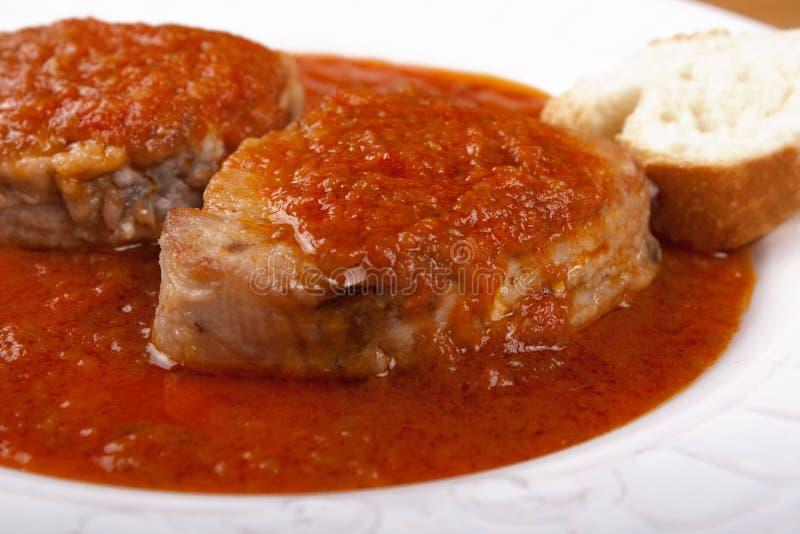 Tuna fish in tomato sauce and a slice of bread. stock photos