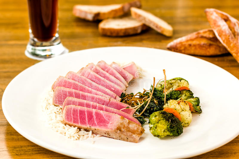 Tuna fish with vegetables and rise royalty free stock image
