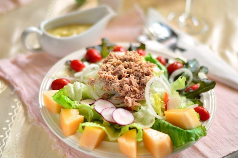 Tuna fresh salad. Fresh salad from vegetables, cheese and tuna royalty free stock photo