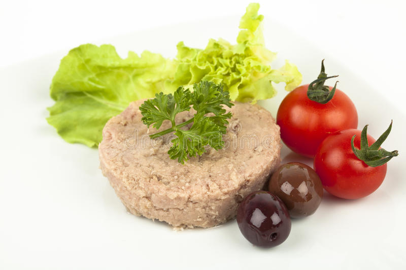Tuna meal. Canned tuna chunks with tomato cherries and olives royalty free stock photos