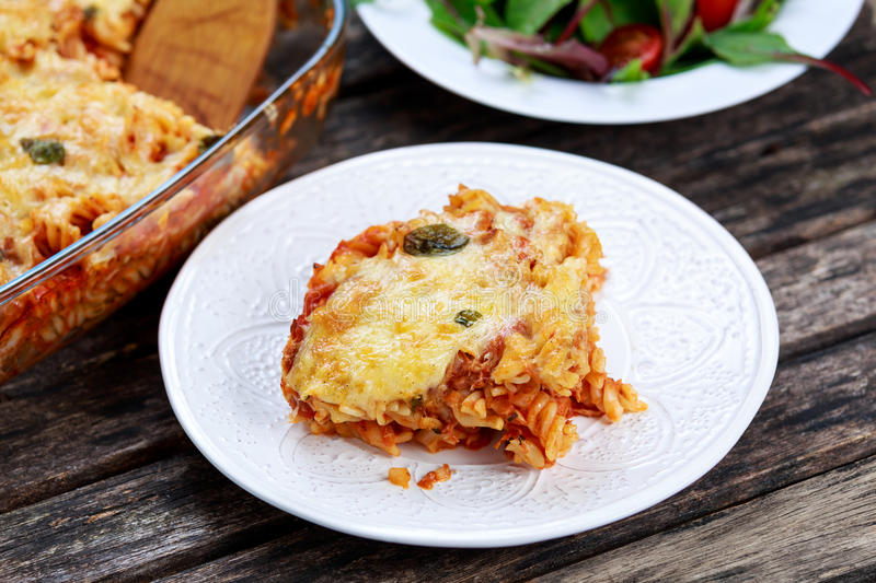 Tuna Pasta Bake with cheese and tomatoes stock image