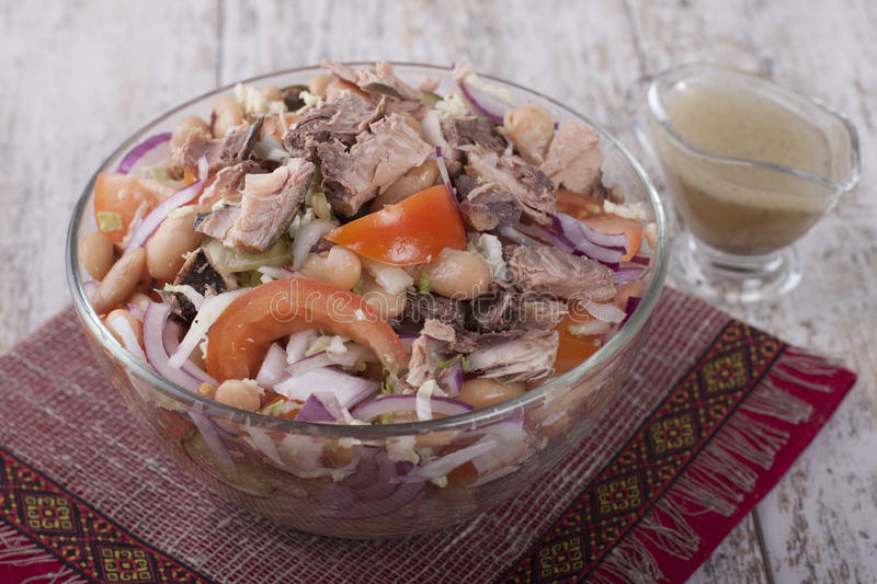 Tuna salad with beans and vegetables. Salad of tuna fish with string beans, cucumber, tomato and lettuce stock images