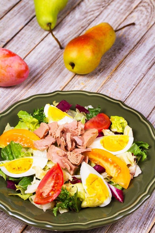 Tuna salad. Fish, eggs and vegetable salad. royalty free stock photos