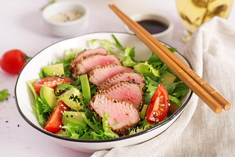 Japanese traditional salad with pieces of medium-rare grilled Ahi tuna royalty free stock photo
