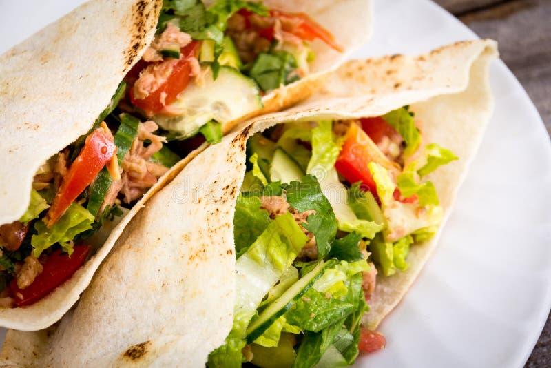 Tuna salad pita sandwich closeup dish royalty free stock photos