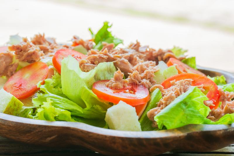 Tuna salad with red raw tomato, fresh lettuce. Hight vitamins and low fat for loose weight. Heathy food concept stock photos