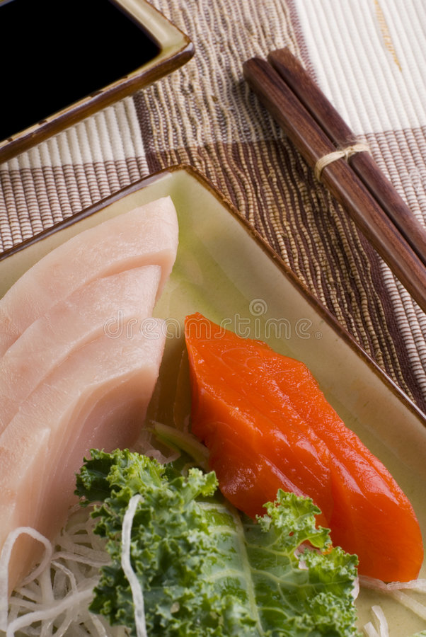 Tuna and Salmon - Sashimi. This image shows a plate of tuna and salmon sashimi royalty free stock photos