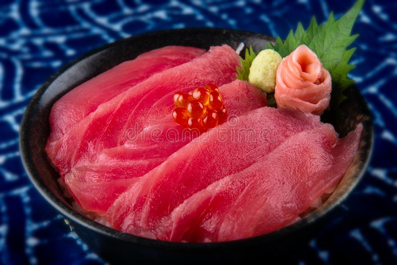 Tuna sashimi with rice and salmond roe on top or maguro don in Japanese style food royalty free stock photos