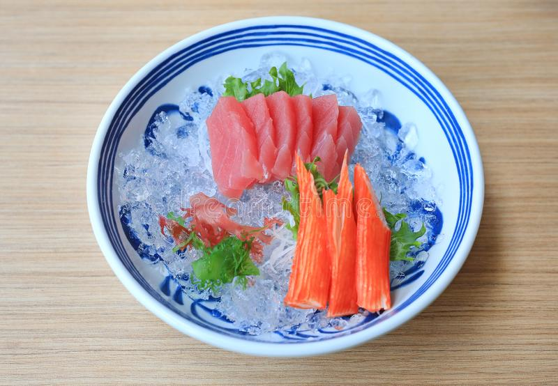Tuna Sashimi served with Seaweed and Crab sticks on ice. Raw fish in traditional Japanese style food royalty free stock images