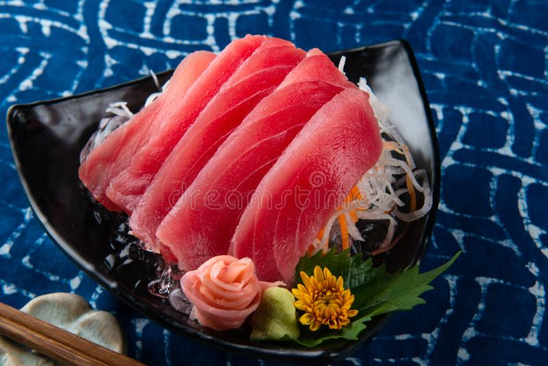 Tuna sashimi slice cutting. stock image