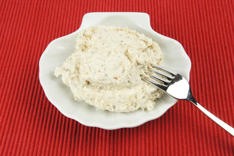 Tuna spread on white shell-shaped plate royalty free stock photography