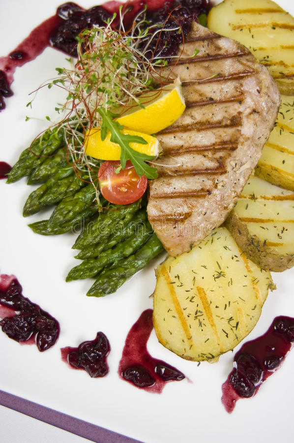 Tuna steak. Elegant restaurant table setting with tuna steak dish stock photo