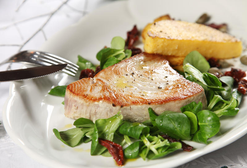 Tuna steak. With polenta and corn salad stock photography